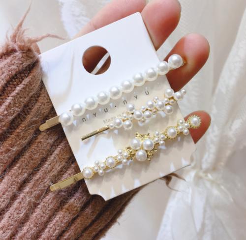 3x Perlen und Blumen als Haarspangen
